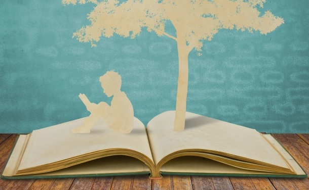 silhouettes-of-a-tree-and-a-man-on-a-book_1232-292